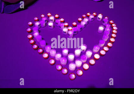 Lourdes sanctuary. Altar candles. Heart shape. - Stock Photo