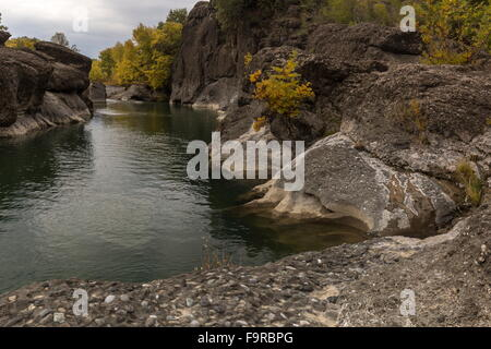 Conglomerate rock in the Venetikos river gorge, south of Grevena, Greece - Stock Photo