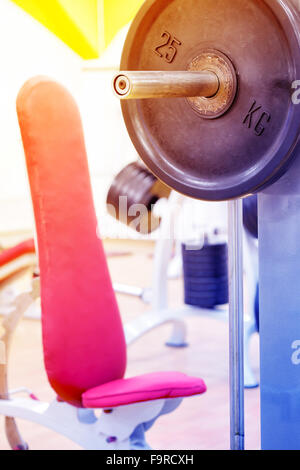 Detail of bar and bench for bench press in gym - Stock Photo