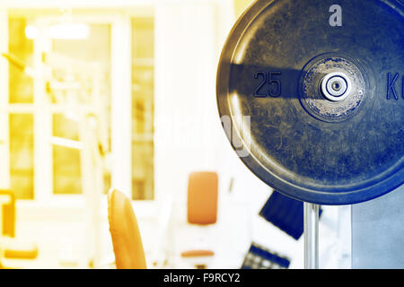 Fragment drive barbell against the background of gym - Stock Photo