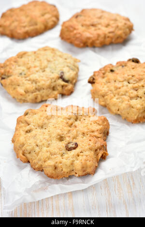 Oats cookies on white baking paper - Stock Photo
