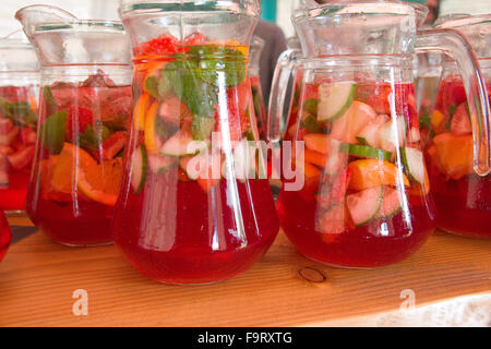 pimms and lemonade drink jug glass glasses refreshing fruit alcoholic drinks alcohol fresh mint gin based tall long - Stock Photo