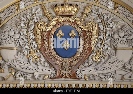 The Louvre Museum. The arms of 'France Moderne': Azure, three fleurs-de-lis or, a simplified version of France Ancienne. - Stock Photo