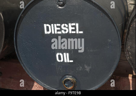 large black metal oil drum for heavy machineary - Stock Photo