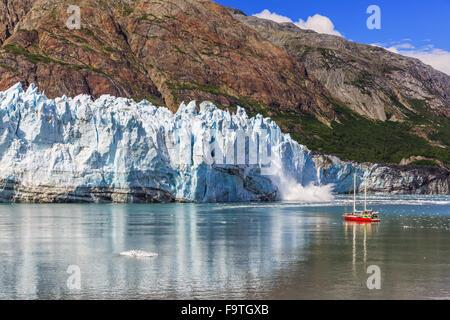 Glacier Bay, Alaska. Ice calving at Margerie Glacier in Glacier Bay National Park - Stock Photo