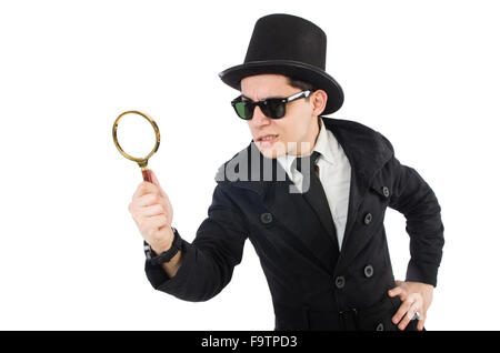 Young detective in black coat holding magnifying glass isolated on white - Stock Photo