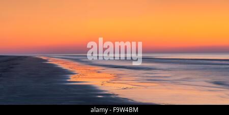 Sunrise At Beach With Blurry Moving Waves & Tide, Hilton Head Island, South Carolina, USA - Stock Photo