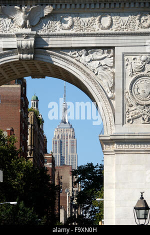 The Empire State Building as seen through the Washington Square Arch in Greenwich Village. New York City USA - Stock Photo