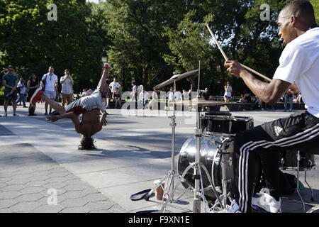 Street performer break dancing at Washington Square Park, Greenwich Village, New York City, USA - Stock Photo