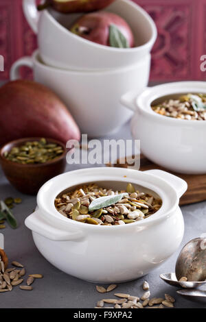 Baked oatmeal with pears and seeds in small pots - Stock Photo