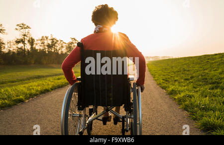 Senior woman in wheelchair in the nature - Stock Photo