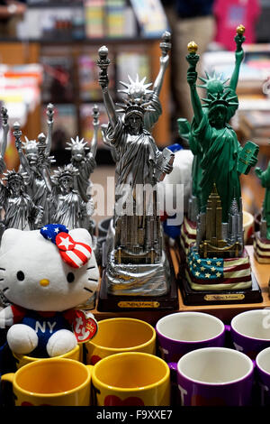 Mini statue of liberty copies for sale as souvenir shop in New York City,USA - Stock Photo
