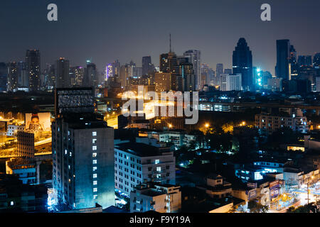 View of skyscrapers at night, in Bangkok, Thailand. - Stock Photo