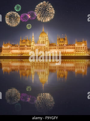 Beautiful fireworks near hungarian Parliament building at night in Budapest, Hungary - Stock Photo