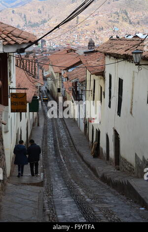Narrow cobblestone streets leading down to the Central District in Cusco, from the Inca ruins of Saksaywaman above - Stock Photo