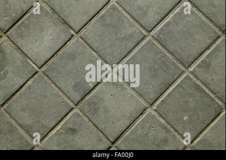 Sidewalk gray sett bricks, texture or background, pavement close up - Stock Photo