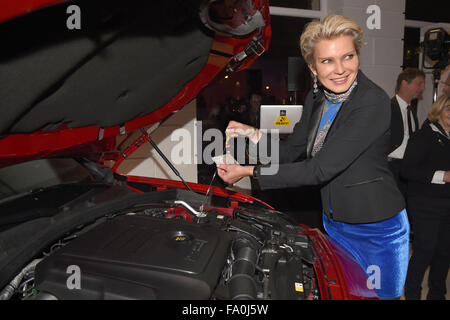 Munich, Germany. 18th Dec, 2015. Countess Stephanie von Pfuel poses for photographers as she measures the oil level - Stock Photo