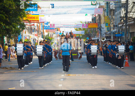 Marching band of young teenagers walking down a downtown street in at the annual Surin Elephant Roundup parade - Stock Photo