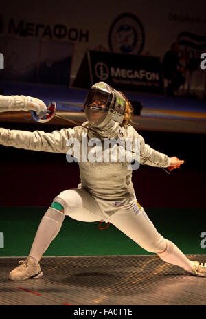 KYIV, UKRAINE - APRIL 13, 2012: Olga Kharlan of Ukraine fights during Womens Sabre Team match against USA at the - Stock Photo