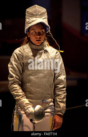 KYIV, UKRAINE - APRIL 13, 2012: Galyna Pundyk of Ukraine fights during Womens Sabre Team match against USA at the - Stock Photo