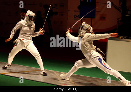 KYIV, UKRAINE - APRIL 13, 2012: Min Zhu of China (L) fights against Leonore Perrus of France during Womens Sabre - Stock Photo