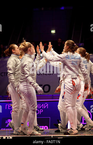KYIV, UKRAINE - APRIL 13, 2012: Ukrainian and Russian fencers cheer each other up before Womens Sabre final match - Stock Photo