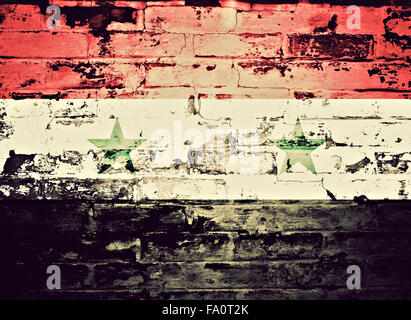 flag of Syria painted on brick wall - Stock Photo