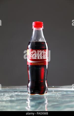 kuala Lumpur,Malaysia 16th April 2015,Editorial photo of Classic Coca-Cola Bottle with water splash - Stock Photo