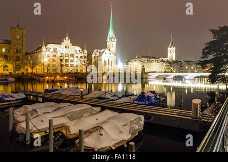 Zurich and the Limmat river on a winter night - Stock Photo