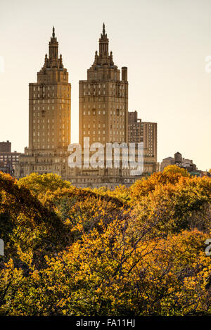 View of the San Remo Building at sunset with Central Park autumn foliage, Upper West Side, Manhattan, New York City - Stock Photo