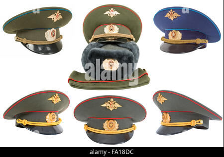 Different russian army officers caps over white background - Stock Photo