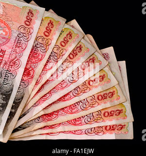 Fifty pound sterling banknotes fanned out with clipping path black background square - Stock Photo