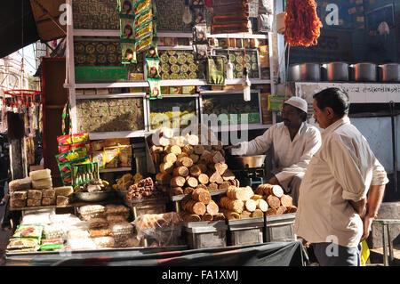Savouries and sweet shops at shrine market place of Ajmer Sharif Dargah,   Mausoleum of Moinuddin Chishti, an Indian - Stock Photo