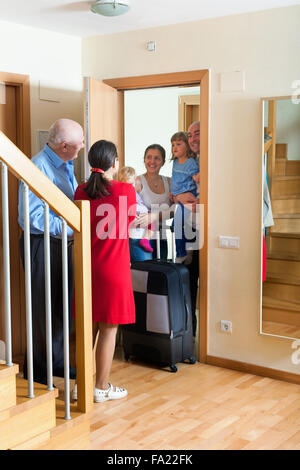 Happy family is coming to kinsfolk home - Stock Photo