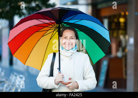 Laughing elderly person with umbrella Stock Photo, Royalty ...