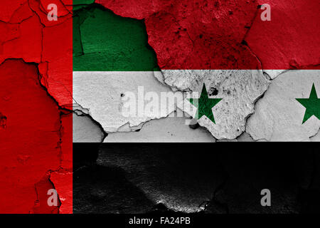 flags of United Arab Emirates and Syria painted on cracked wall - Stock Photo