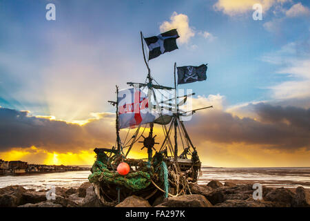 Hoylake, Wirral, 20th December, 2015.   UK Weather.  Storm skies over the Driftwood Boat, a children art project. - Stock Photo