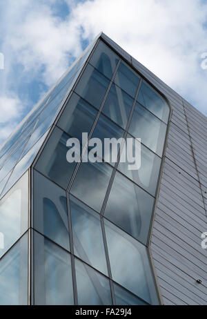 Contemporary apartment tower (HL23) in New York City with a cloudy blue sky reflected in the glass - Stock Photo
