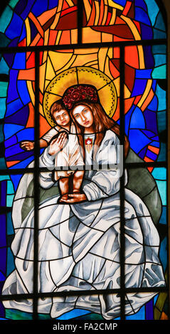 Stained Glass window depicting Madonna with Child in the Cathedral of Madrid, Spain. - Stock Photo