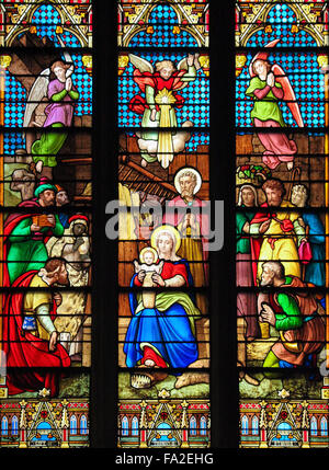 NEW YORK, US - SEPTEMBER 14, 2012: Stained Glass window depicting a Nativity Scene at Christmas in St. Patrick's - Stock Photo