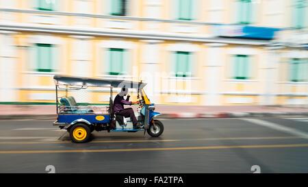 Tuk-Tuk is the name of Thailand style taxi. You can see many Tuk-Tuk at Bangkok, Thailand. - Stock Photo