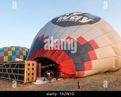 Inflating a hot air balloon before a flight over Cappadocia, Central Anatolia, Turkey. - Stock Photo