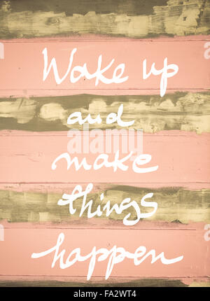 Concept image of Wake Up and Make Things Happen motivational quote hand written on vintage painted wooden wall - Stock Photo