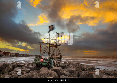 Hoylake, Wirral, 20th December, 2015.   UK Weather Storm skies over the Driftwood Boat the 'Grace Darling' on Hoylake's - Stock Photo