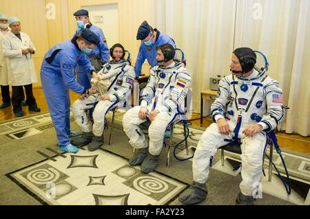 International Space Station Expedition 46 crew members have their Russian Sokol space suits adjusted in Building - Stock Photo
