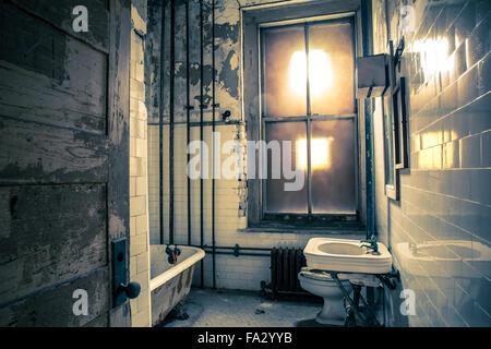Creepy bathroom in abandoned hospital - Stock Photo