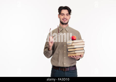 Portrait of a casual man holding glasses and books isolated on a white background - Stock Photo