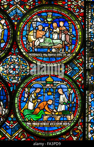 Medieval stained glass in Canterbury cathedral - Stock Photo