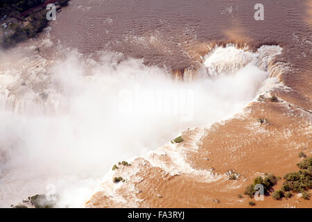 Aerial view of the Devil's Throat at the Iguacu / Iguazu/Iguassu falls in Argentina/Brazil - Stock Photo