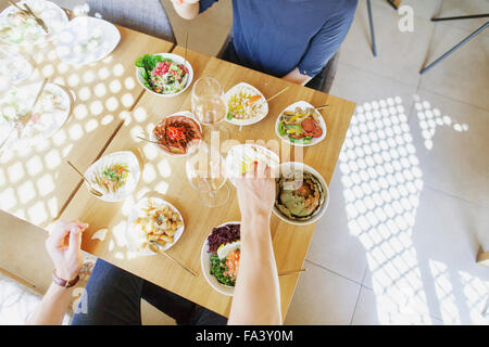 High angle view of couple having meze at Lebanese restaurant - Stock Photo